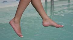 Pool bathing suit model sitting Stock Footage