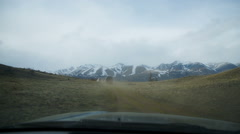 Car rides across country in the mountains Stock Footage