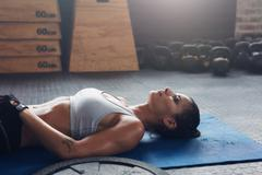 Healthy female athlete taking a break from fitness training Stock Photos