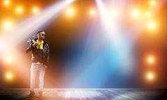 Rock star on stage Stock Photos