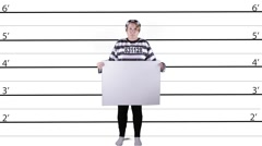 Female criminal holding white sign in front of lineup Stock Footage