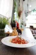 Spaghetti bolognese on wood background Stock Photos
