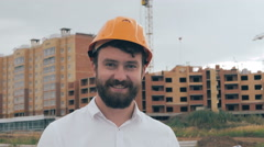 Professional engineer, constructor at work in construction site, looking at Stock Footage