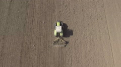 Aerial view of tractor harrow on a field Stock Footage