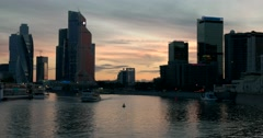 The skyscrapers, the sun set over the horizon, , ship sails on the Moscow river Stock Footage