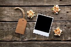 Instant photo frame with gift tag and flowers Stock Photos