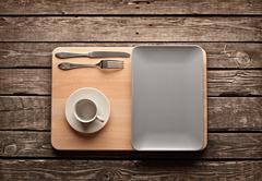 Empty ceramic dish with  coffee cup Stock Photos