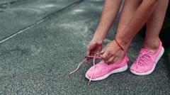 Athlete tying shoelaces Stock Footage
