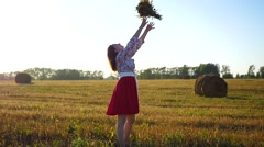 Girl with a bouquet of flowers at sun Stock Footage