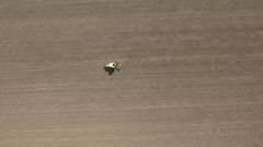 Aerial shot of tractor harrow on a field Stock Footage