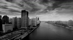 Dramatic aerial shot of city skyline and cloudscape  Stock Footage