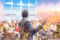 Speaker giving talk at Business Conference. Stock Photos