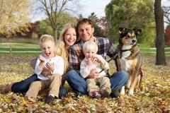 Happy Family of Four People and Dog OUtside in Autumn Stock Photos