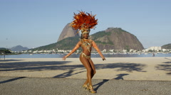 Samba dancing in full costume in Rio de Janiero beach Stock Footage