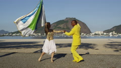 Dancing samba couple in Rio de Janiero beach Stock Footage