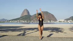 Gymnest doing cartwheel on beach Stock Footage