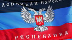 Donetsk People's Republic flag waving against clean blue sky, close up, isola Stock Photos