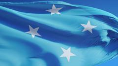Federated States of Micronesia flag waving against clean blue sky, close up,  Stock Photos
