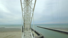 POV riding a ferry wheel on a beach in Nieuwpoort, Belgium Stock Footage