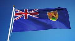 Turks and Caicos Islands flag waving against clean blue sky, close up, isolat Stock Photos