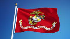 United States Marine Corps flag waving against clean blue sky, close up, isol Stock Photos