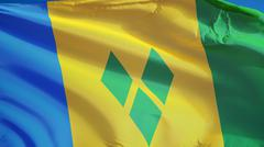 Vincent and the Grenadines flag waving against clean blue sky, close up, isol Stock Photos