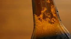 Foam in a brown bottle of beer (close-up, LR Pan) Stock Footage