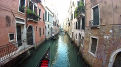 Tourists enjoying the gondolas in the canals near the Bridge of Sighs, Venice Stock Footage