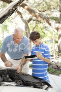 Father Son Auto Repair with Copyspace Stock Photos