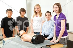 Teenagers with CPR Training Mannequin Stock Photos