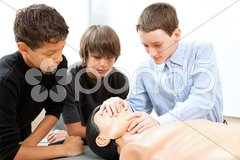 Boys Practicing CPR Stock Photos