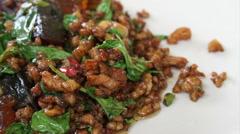 Thai local everyday food, pork basil stir fries on table Stock Footage