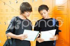 Teen Boys Comparing Homework Stock Photos