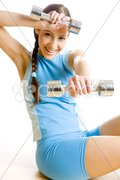 Woman with dumb bells at gym Stock Photos