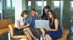 Four business people working at meeting Stock Footage