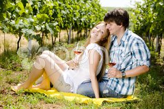 Couple at a picnic in vineyard Stock Photos