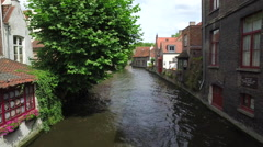 "WIDE FIXED Establishing shot of water canal in Bruges, ""Venice of the North"" Stock Footage"