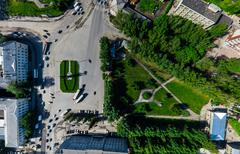 Aerial city view with crossroads and roads, houses buildings. Copter shot Stock Photos