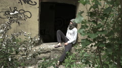Refugee arabic boy in a ruined building - orphan and homeless Stock Footage