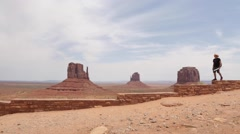 Young Man Exploring Monument Valley in Utah Stock Video Stock Footage