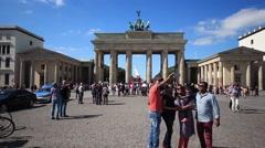 Family making selfie in front of Brandenburg Gate in Berlin, Germany Stock Footage