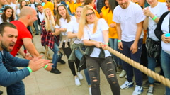 "Young women compete in a rope pulling "" ""Tug Of War"" on sport games Stock Footage"