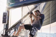 Man adjusting sailing equipment Stock Photos