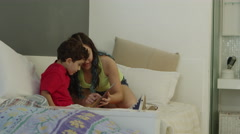 Sister teaching little brother how to use tablet Stock Footage