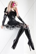Young woman with dreadlocks wearing extravagant clothes and boots Stock Photos