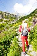 Woman backpacker in Great Cold Valley, Vysoke Tatry (High Tatras), Slovakia Stock Photos