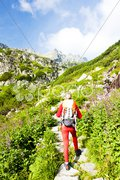 Woman backpacker in Great Cold Valley, Vysoke Tatry (High Tatras), Slovakia Stock Photos