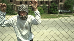 Refugee arabic boy behind a fence - orphan and homeless Stock Footage