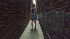 4K TRACKING shot of a young female walking on the streets of Liege, Belgium Stock Footage