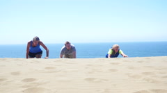 Friends climb to the top of the sand dune Stock Footage
